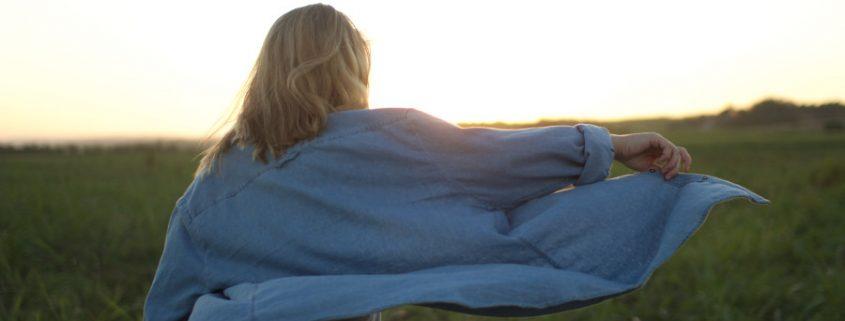 woman approaching sunrise