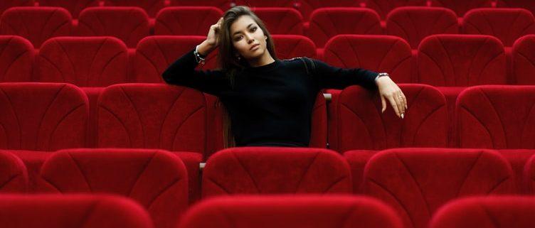 woman sitting in theater